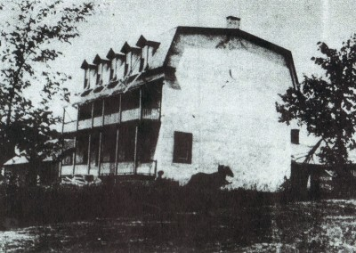 The oldest known photograph of the Bishop's House, probably taken around 1900. The original 1808 gable roof was replaced in 1880 by the Mansard roof, seen here. Matching east and west wings were added in 1924.