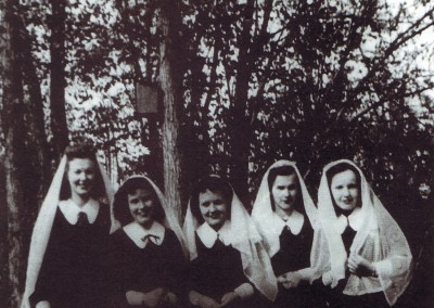 Iona Academy students in their uniforms on the grounds of Iona Academy in the 1940s.