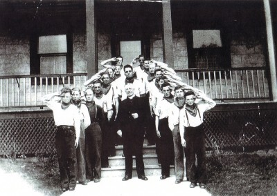 Father D. C. Campbell and a boys' brigade on the steps of the Bishop's House around 1940. Father Campbell was pastor of St. Raphael's for more than 50 years.