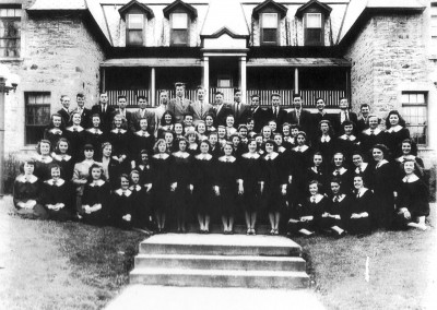 The graduating class of Iona Academy in front of the Bishop's House, St. Raphael's, circa 1947