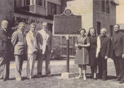 The unveiling of the provincial plaque honouring the College of Iona, in the front yard of the Bishop's House, 1975. The bishop of the Diocese of Alexandria-Cornwall at the time, Eugene LaRocque, is at right.
